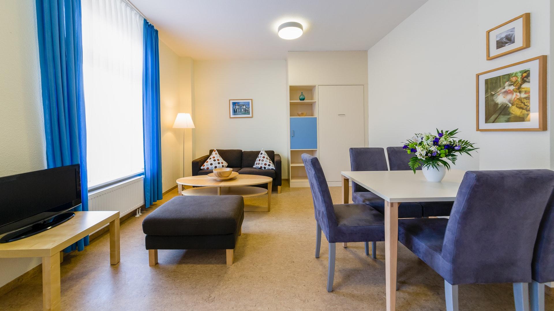 8 Michels_Hotels_Haus_Wilhelm_Augusta_3Raum_Ferienwohnung_Wohnbereich